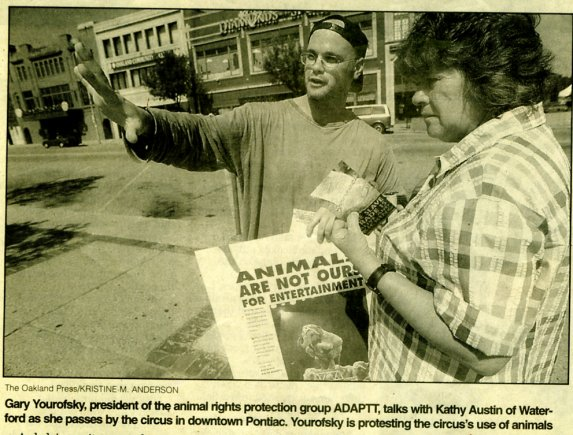 Gary Yourofsky, president of ADAPTT, talks with Kathy Austin of Waterford as she passes by the circus in downtown Pontiac. Yourofsky is protesting the circus's use of animals.
